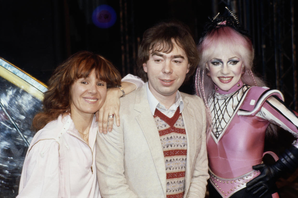 Arlene Phillips, British choreographer, Andrew Lloyd-Webber, British composer, and Stephanie Lawrence (1949-2000), British actress, posing for a group portrait at their musical 'Starlight Express', at the Apollo Victoria Theatre in London, England, United Kingdorm, 1984. Lawrence is in costume for the role of Pearl in the stage musical. (Photo by Fox Photos/Hulton Archive/Getty Images)
