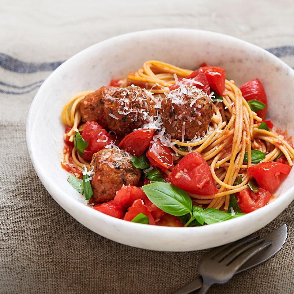 <p>This crowd-pleasing and easy dinner recipe takes just 20 minutes to make, start to finish, so it's perfect for weeknights! When tomatoes are at their in-season best, just a quick chop and a few ingredients are all you need to make a spaghetti sauce in minutes. Store-bought chicken meatballs keep the low-effort theme going all the way to the table.</p>