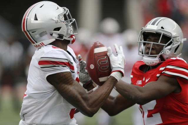 Ohio State receiver Binjimen Victor, left, makes a catch as defensive back Sevyn Banks defends during their NCAA college spring football game Saturday, April 14, 2018, in Columbus, Ohio. (AP Photo/Jay LaPrete)