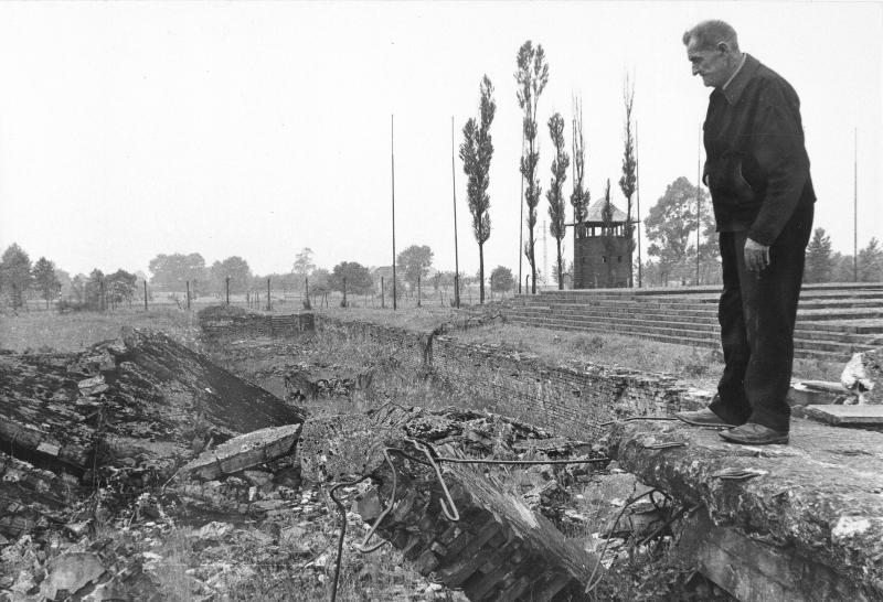 FILE - In this undated file photo from 1979, a former inmate of the Nazi concentration camp at Auschwitz-Birkenau, Poland sometime in 1979, gazes down at ruins of gas chambers where hundreds of people were exterminated during World War II.  The oldest known survivor of the Auschwitz concentration camp, a teacher who gave lessons in defiance of his native Poland's Nazi occupiers has died at the age of 108, an official said Monday, Oct. 22, 2012. Antoni Dobrowolski died Sunday in the northwestern Polish town of Debno, according to Jaroslaw Mensfelt, a spokesman at the Auschwitz-Birkenau state museum. (AP Photo/Horst Faas, File)