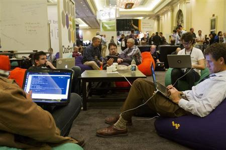 Developers and programmers participate in a coding challenge at the AWS Re:Invent conference in Las Vegas
