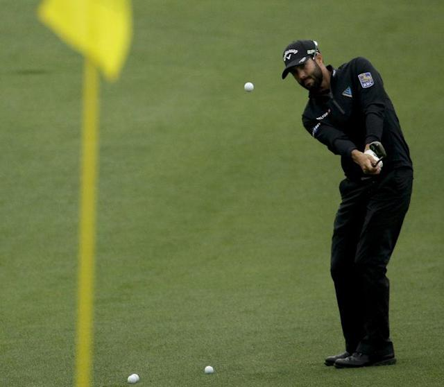 Adam Hadwin chips to the green on the second hole during a practice round for the Masters golf tournament Monday, April 3, 2017, in Augusta, Ga. (AP Photo/Charlie Riedel)