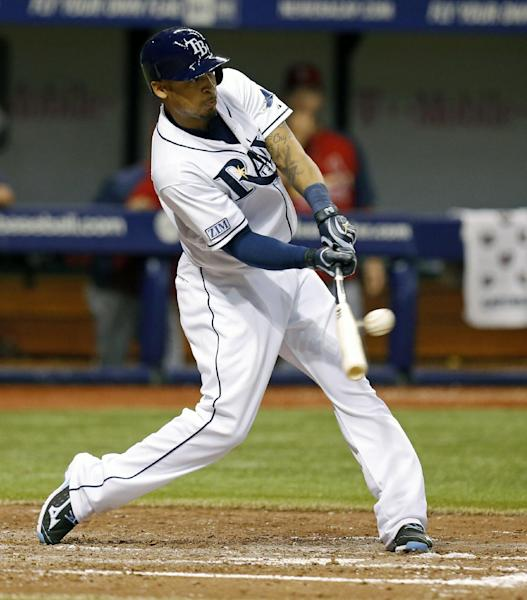 Tampa Bay Rays' Desmond Jennings singles in two runs during the fourth inning of a baseball game against the St. Louis Cardinals Wednesday, June 11, 2014, in St. Petersburg, Fla. (AP Photo/Mike Carlson)