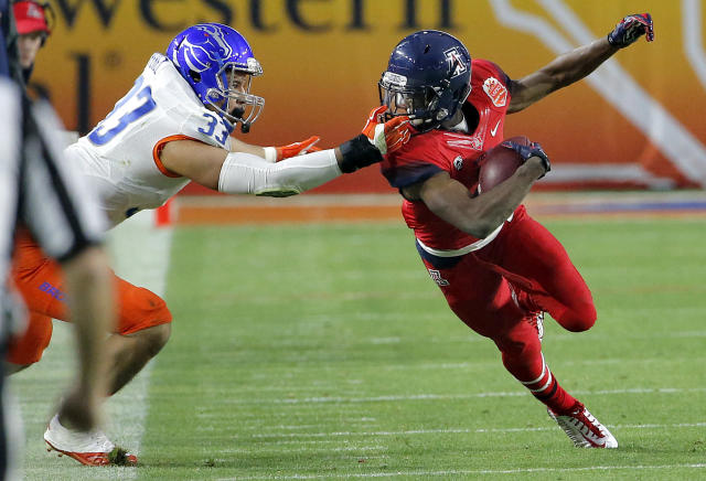 Boise State linebacker Gabe Perez (33) pulls Arizona running back Tyrell Johnson out of bounds during the second half of the Fiesta Bowl NCAA college football game, Wednesday, Dec. 31, 2014, in Glendale, Ariz. (AP Photo/Ross D. Franklin)