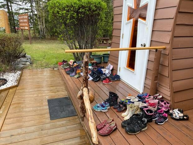 Childrens' shoes were also left outside the catholic church in Haines Junction, Yukon, on Monday.