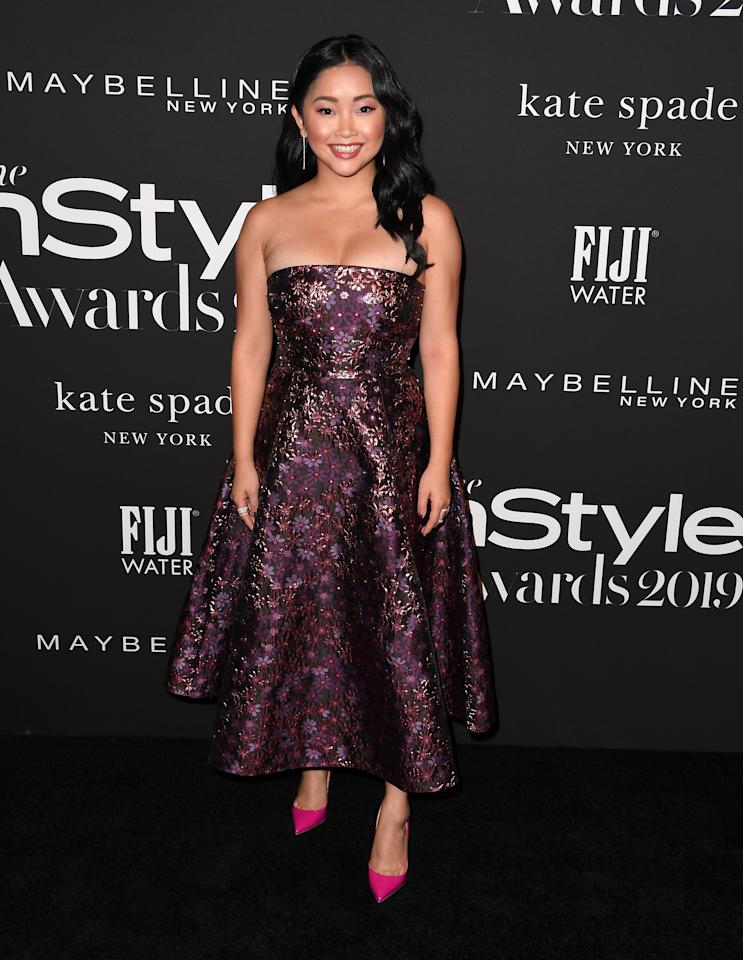 Serving up major Old Hollywood vibes in this purple gown.