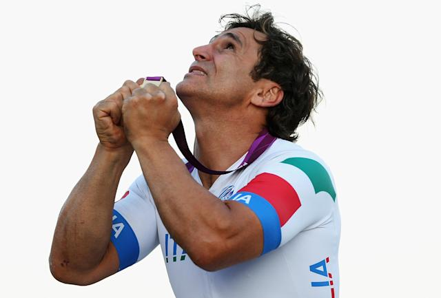 LONGFIELD, ENGLAND - SEPTEMBER 07: Alessandro Zanardi of Italy celebrates with his gold medal after winning the Men's Individual H4 Road Race on day 9 of the London 2012 Paralympic Games at Brands Hatch on September 7, 2012 in Longfield, England. (Photo by Bryn Lennon/Getty Images)