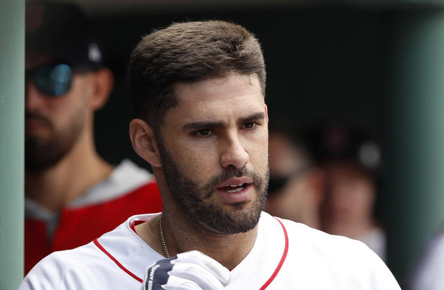 Boston Red Sox's J.D. Martinez is congratulated in the dugout after his home run against the Toronto Blue Jays during the fourth inning of a baseball game Saturday, July 14, 2018, in Boston. (AP Photo/Winslow Townson)