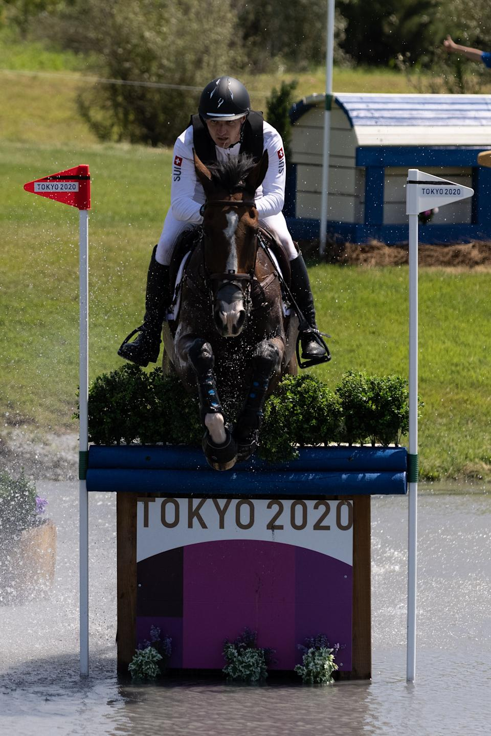 <p>Switzerland's Robin Godel riding Jet Set competes in the equestrian's eventing team and individual cross country during the Tokyo 2020 Olympic Games at the Sea Forest Cross Country Course in Tokyo on August 1, 2021. (Photo by Yuki IWAMURA / AFP) (Photo by YUKI IWAMURA/AFP via Getty Images)</p>