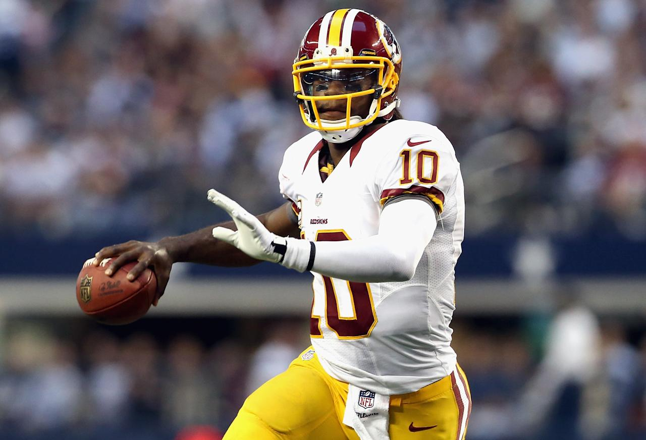 ARLINGTON, TX - NOVEMBER 22:   Robert Griffin III #10 of the Washington Redskins throws the ball against the Dallas Cowboys during a Thanksgiving Day game at Cowboys Stadium on November 22, 2012 in Arlington, Texas.  (Photo by Ronald Martinez/Getty Images)