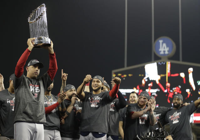 Alex Cora holds the championship trophy after Game 5 of the 2018 World Series against the Los Angeles Dodgers. With Cora under scrutiny, both the 2017 and 2018 World Series are now in question. (AP Photo/Jae C. Hong)