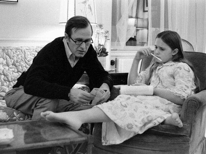 George H.W. Bush helping his daughter Dorothy with homework in 1971.