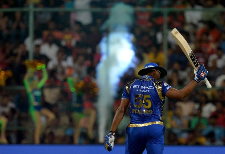 <p>Mumbai Indians batsman Kieron Pollard raises his bat as he celebrates after scoring a half-century (50 runs) during the 2017 Indian Premier League (IPL) Twenty20 cricket match between Royal Challengers Bangalore and Mumbai Indians at The M.Chinnaswamy Stadium in Bangalore on April 14, 2017. ——IMAGE RESTRICTED TO EDITORIAL USE – STRICTLY NO COMMERCIAL USE—– / GETTYOUT—— / AFP PHOTO / Manjunath KIRAN / —-IMAGE RESTRICTED TO EDITORIAL USE – STRICTLY NO COMMERCIAL USE—– / GETTYOUT </p>