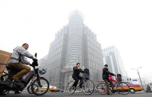 An office building stands out amid a hazy smog engulfing Beijing