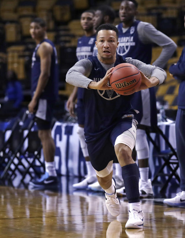 Villanova's Jalen Brunson passes the ball during practice at the NCAA men's college basketball tournament in Boston, Thursday, March 22, 2018. Villanova faces West Virginia in a regional semifinal on Friday night. (AP Photo/Charles Krupa)