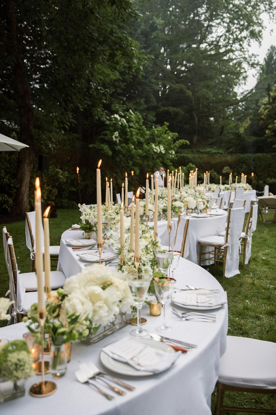 The 70-foot serpentine tablescape Fete designed was so unique and beautiful. The flowers on the table included gorgeous peonies, lilac, lisianthus, ranunculus, scabiosa, and French tulips. Truly perfection.