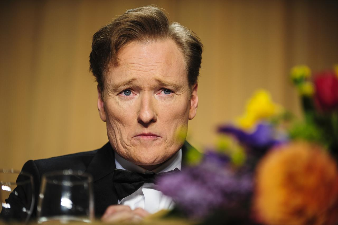 WASHINGTON, DC - APRIL 27:  Comedian Conan O'Brien looks into the audience during the White House Correspondents' Association Dinner on April 27, 2013 in Washington, DC. The dinner is an annual event attended by journalists, politicians and celebrities. (Photo by Pete Marovich-Pool/Getty Images)