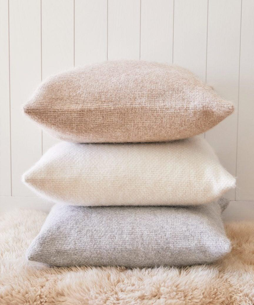 <p>No one will refuse this <span>Jenni Kayne Alpaca Basketweave Pillow</span> ($195) in every shade.</p>