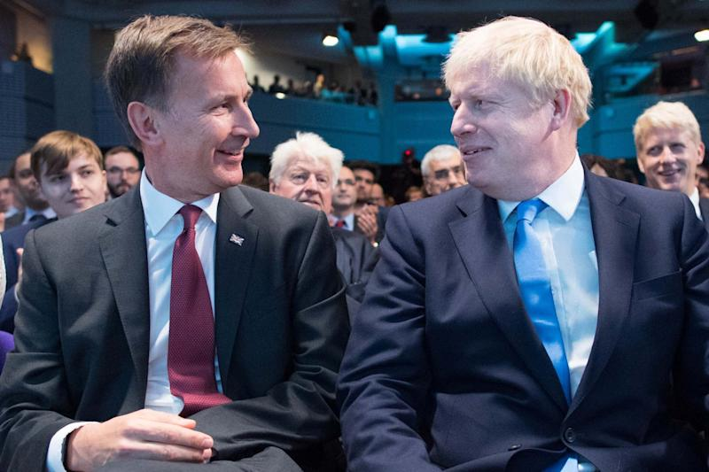 Jeremy Hunt and Boris Johnson, pictured together as Mr Johnson was announced the new Conservative party leader (EPA)