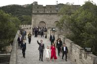 Prime Minster Justin Trudeau waves while walking with his wife Sophie Gregoire Trudeau and daughter Ella-Grace on the Badaling section of the Great Wall in Beijing, China, on Sept. 1, 2016. (The Associated Press/Mark Schiefelbein)