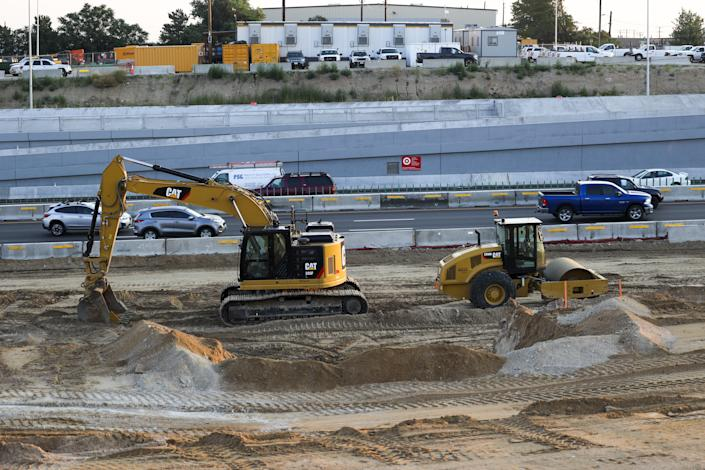 A construction crew works at a site for the Colorado Central 70 project at Interstate 70 in Denver, on Thursday.