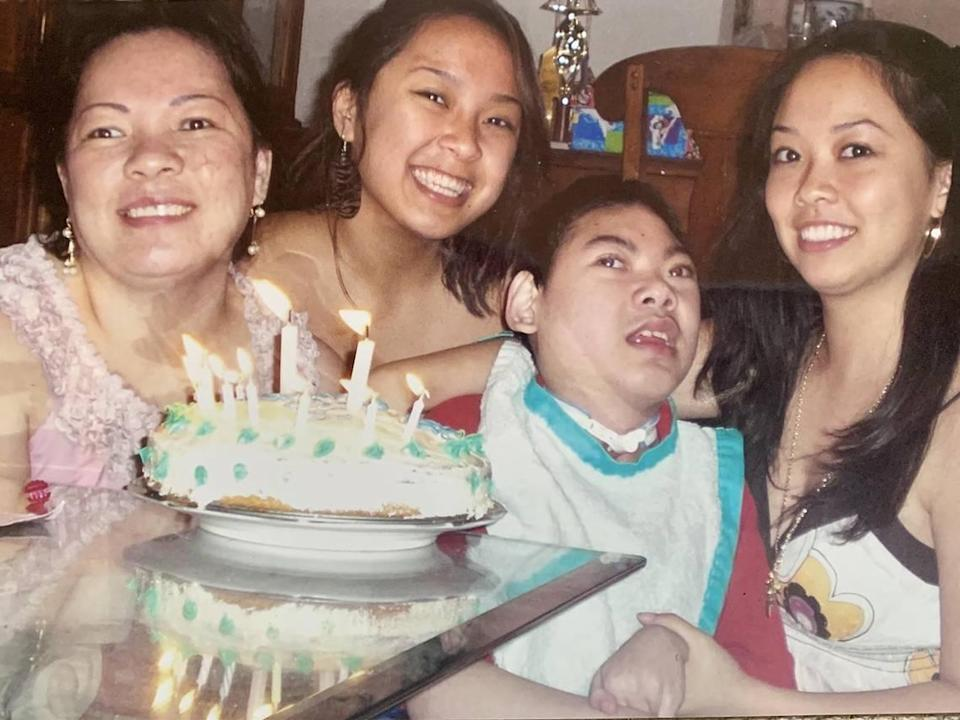Justin Nguyen is surrounded by his mother, Julie, and his sisters Jennifer and Jessica Pham as they celebrate his 12th birthday. Every one of Justin's birthday is a big celebration in the family as they say they never know how many more years Justin will be with them.