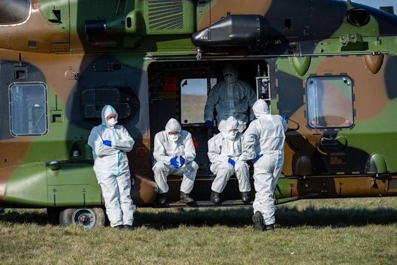 French medics wait for a German ambulance to arrive to transport two French patients infected with the coronavirus Covid-19 at a small airport near Nordhausen, eastern Germany on April 2, 2020. Source: JENS SCHLUETER/AFP via Getty Images