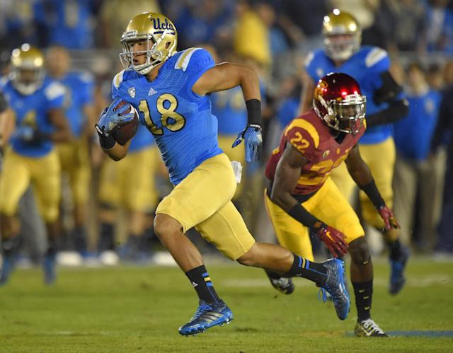 UCLA wide receiver Thomas Duarte, left, runs the ball for a touchdown as Southern California safety Leon McQuay gives chase during the first half of an NCAA college football game, Saturday, Nov. 22, 2014, in Pasadena, Calif. UCLA won 38-20. (AP Photo/Mark J. Terrill)