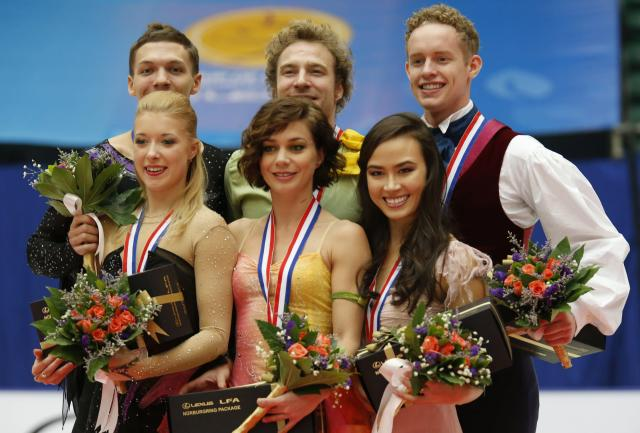 Second-place medalists Ekaterina Bobrova (front L) and Dmitri Solovie (back L) of Russia, winners Nathalie Pechalat (front C) and Fabian Bourzat (back C) of France and third-place medalists Madison Chock (front R) and Evan Bates of the U.S. pose at the award ceremony for the ice dance free dance programme during the ISU Grand Prix of Figure Skating in Beijing, November 2, 2013. REUTERS/Kim Kyung-Hoon (CHINA - Tags: SPORT FIGURE SKATING)