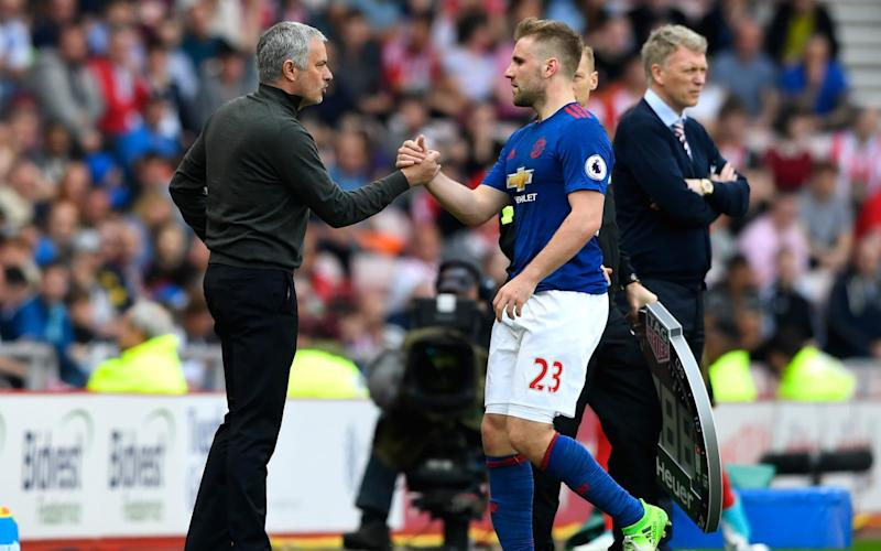 Jose Mourinho put his arm around Luke Shaw when the player was substituted against Sunderland  - Getty Images Europe