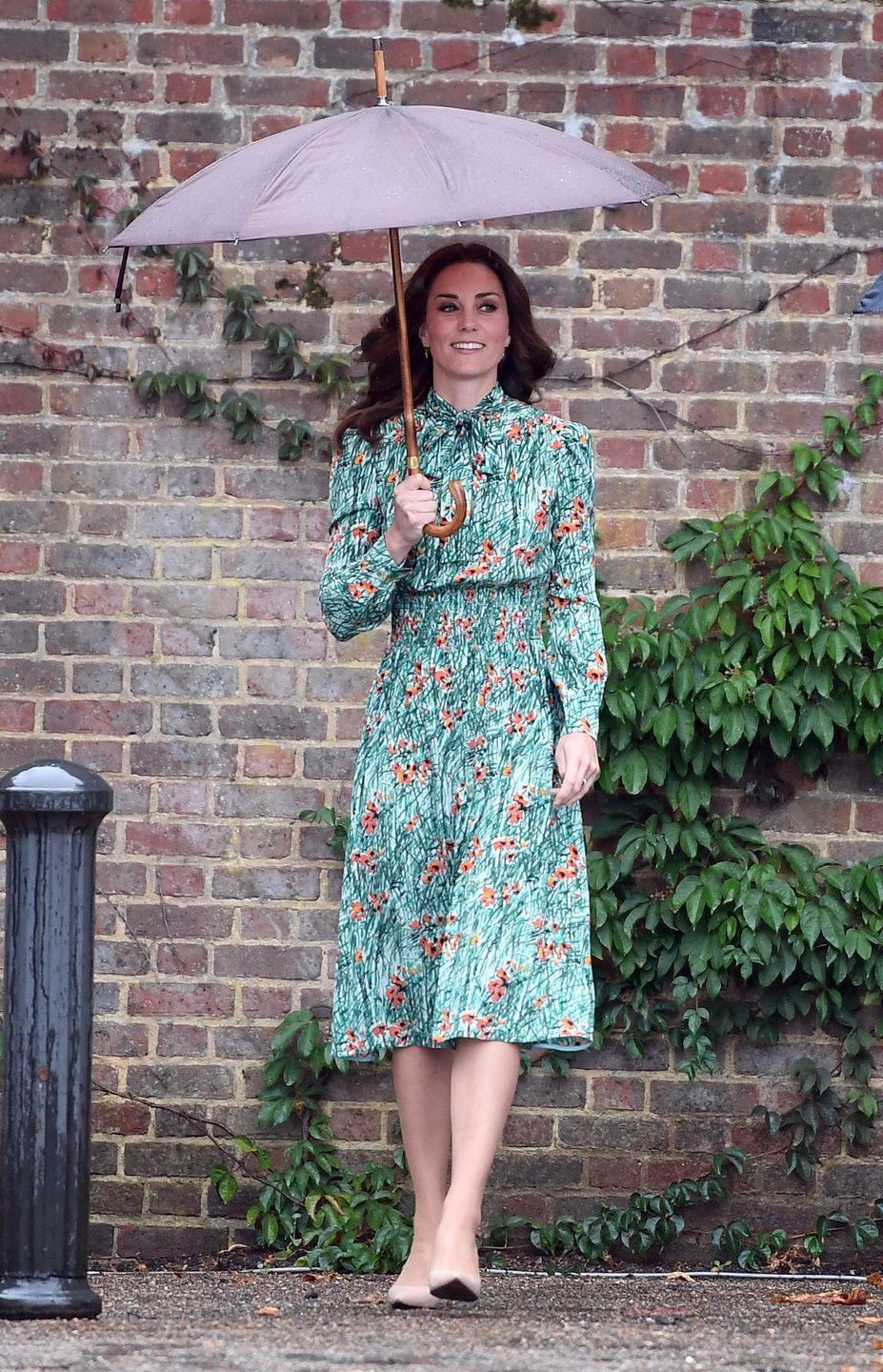 """<p>Kate chose a green tea-length Prada dress with poppy print for a visit to Diana's memorial garden on the 20th anniversary of her death in 2017. It's a subtle but lovely tribute to Diana, according to <em><a href=""""https://www.instyle.com/news/kate-middleton-prince-william-harry-diana-memorial-garden"""" rel=""""nofollow noopener"""" target=""""_blank"""" data-ylk=""""slk:InStyle"""" class=""""link rapid-noclick-resp"""">InStyle</a></em>, as poppies signify remembrance in the UK. The dress also featured a bow neckline, a style Diana often wore herself. </p>"""