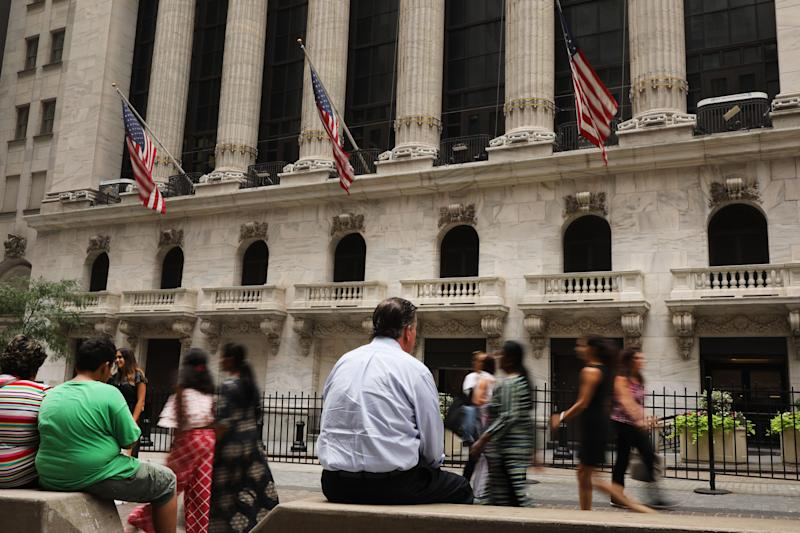 People walk by the New York Stock Exchange (NYSE) on August 14, 2019 in New York City. 56