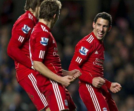 Liverpool's Maxi (R) celebrates scoring the opening goal against Chelsea