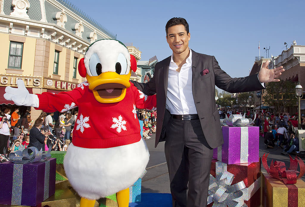 'The X-Factor' host Mario Lopez poses with Donald Duck during the taping of the '2012 Disney Parks Christmas Day Parade' holiday TV special at Disneyland in Anaheim, California. The annual show airs Christmas Day, at various times across the country, on ABC-TV. (Paul Hiffmeyer/ Disneyland)