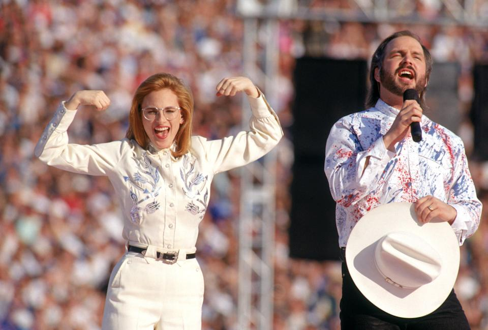 Country music star Garth Brooks sings the National Anthem with American sign language translation performed by actress Marlee Matlin prior to Super Bowl XXVII between the Dallas Cowboys and the Buffalo Bills at the Rose Bowl on January 31, 1993 in Pasadena, California. The Cowboys defeated the Bills 52-17.