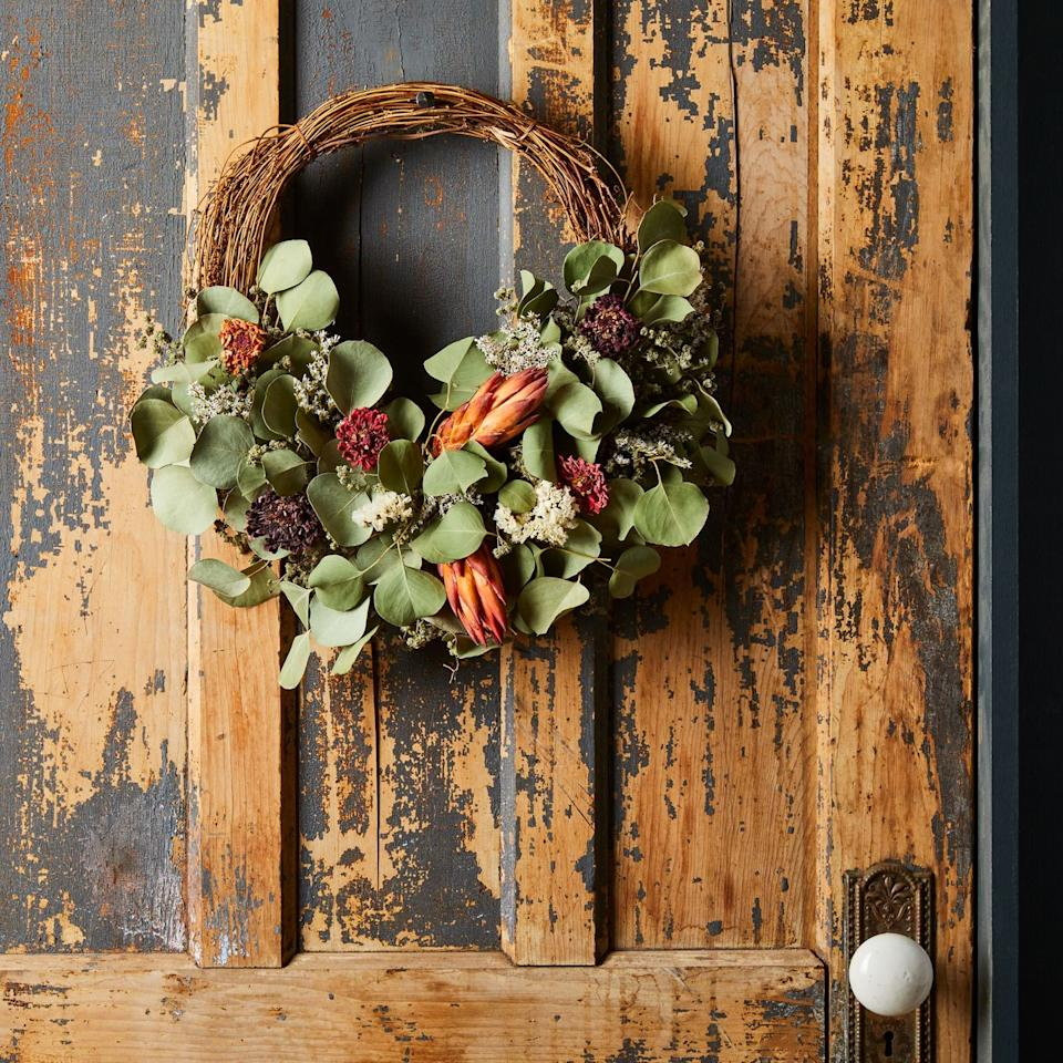 "<p>For a tasteful Halloween wreath that's beautifully crafted, hang this wreath from Creekside Farms. The dried florals and robust leaves covering half of the branches make it perfect for fall, so you can keep it hanging after October 31st. </p><p><a class=""body-btn-link"" href=""https://go.redirectingat.com/?id=74968X1525080&xs=1&url=https%3A%2F%2Ffood52.com%2Fshop%2Fproducts%2F5814-dried-protea-half-branch-wreath&sref=https%3A%2F%2Fwww.housebeautiful.com%2Fhome-remodeling%2Fdiy-projects%2Fg2586%2Ffall-wreaths%2F"" target=""_blank"">BUY NOW</a> <strong><em>Creekside Farms Dried Protea Wreath, $59</em></strong></p>"