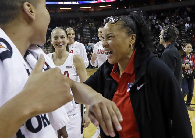 U.S. coach Dawn Staley, right, greets players after the team defeated China 83-46 in an exhibition basketball game Thursday, April 26, 2018, in Seattle. (AP Photo/Elaine Thompson)