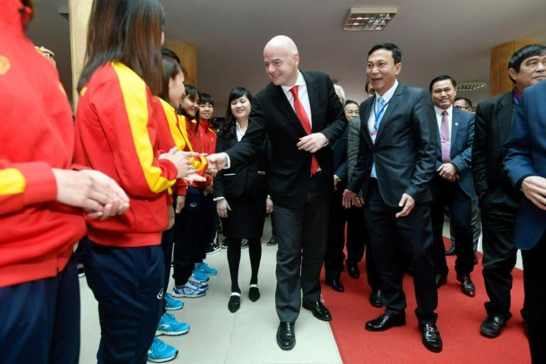 FIFA president Gianni Infantino greets Vietnam's women's national football team during a visit to Hanoi