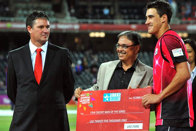 Mitchell Stark () of the Sixers receives the award for Man of the Series during the Karbonn Smart CLT20 Final match between bizhub Highveld Lions and Sydney Sixers at Bidvest Wanderers Stadium on October 28, 2012 in Johannesburg, South Africa. (Photo by Duif du Toit/Gallo Images/Getty Images)