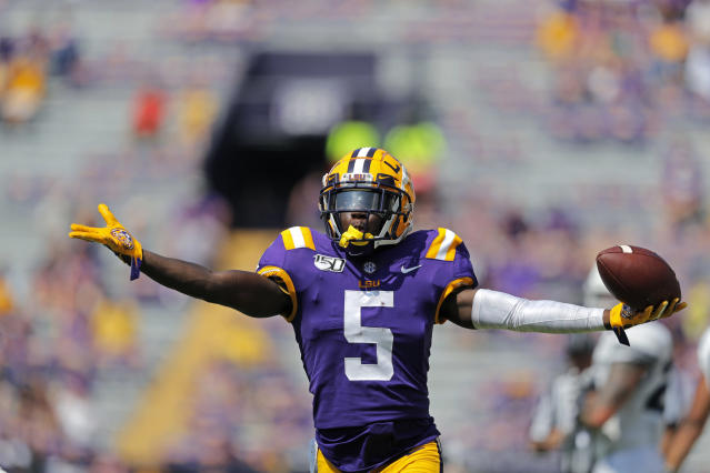 LSU cornerback Kary Vincent Jr. (5) celebrates his interception in the second half of an NCAA college football game against Utah State in Baton Rouge, La., Saturday, Oct. 5, 2019. LSU won 42-6. (AP Photo/Gerald Herbert)