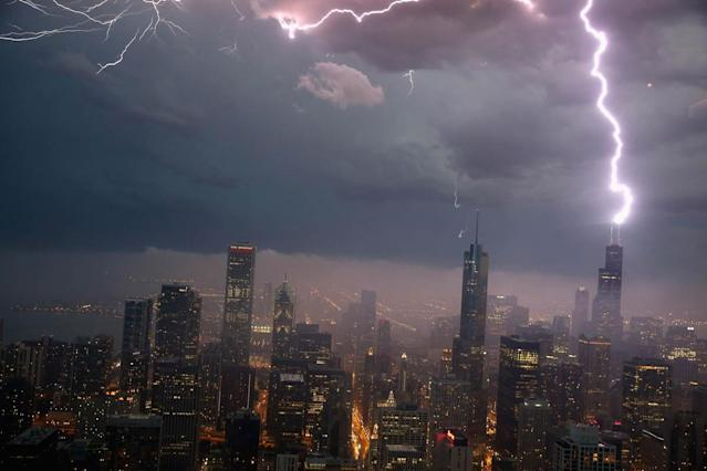 Lightning strikes the Willis Tower (formerly Sears Tower) in downtown on June 12, 2013 in Chicago, Illinois. A massive storm system with heavy rain, high winds, hail and possible tornadoes is expected to move into Illinois and much of the central part of the Midwest today. (Photo by Scott Olson/Getty Images)