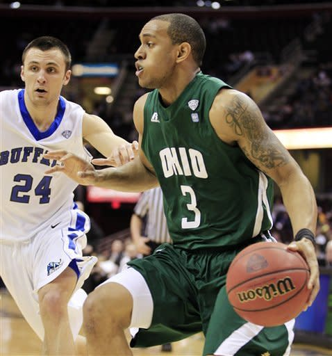 Ohio's Walter Offutt (3) drives past Buffalo's Dave Barnett in the first half of an NCAA college basketball game in the Mid-American Conference semifinals, Friday, March 9, 2012, in Cleveland. (AP Photo/Tony Dejak)