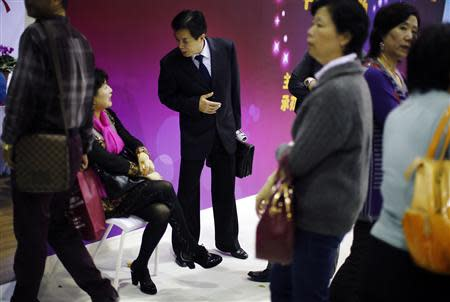 A man and a woman chat during a matchmaking event for middle-aged singles and seniors, sponsored by Shanghai's government, in Shanghai November 9, 2013. REUTERS/Carlos Barria