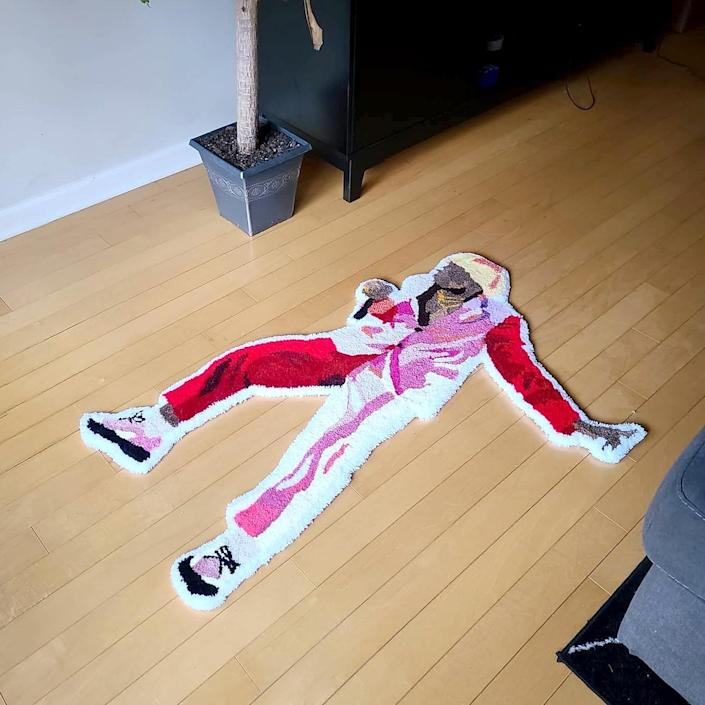 """A rug based on Tyler, the Creator in the look he used to perform his album """"IGOR."""""""