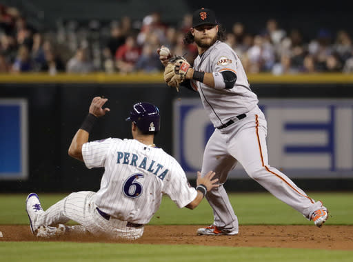 San Francisco Giants' Brandon Crawford forces out Arizona Diamondbacks David Peralta (6) as he tries to throw out Ketel Marte during the third inning of a baseball game Thursday, April 19, 2018, in Phoenix. Marie was safe at first. (AP Photo/Matt York)