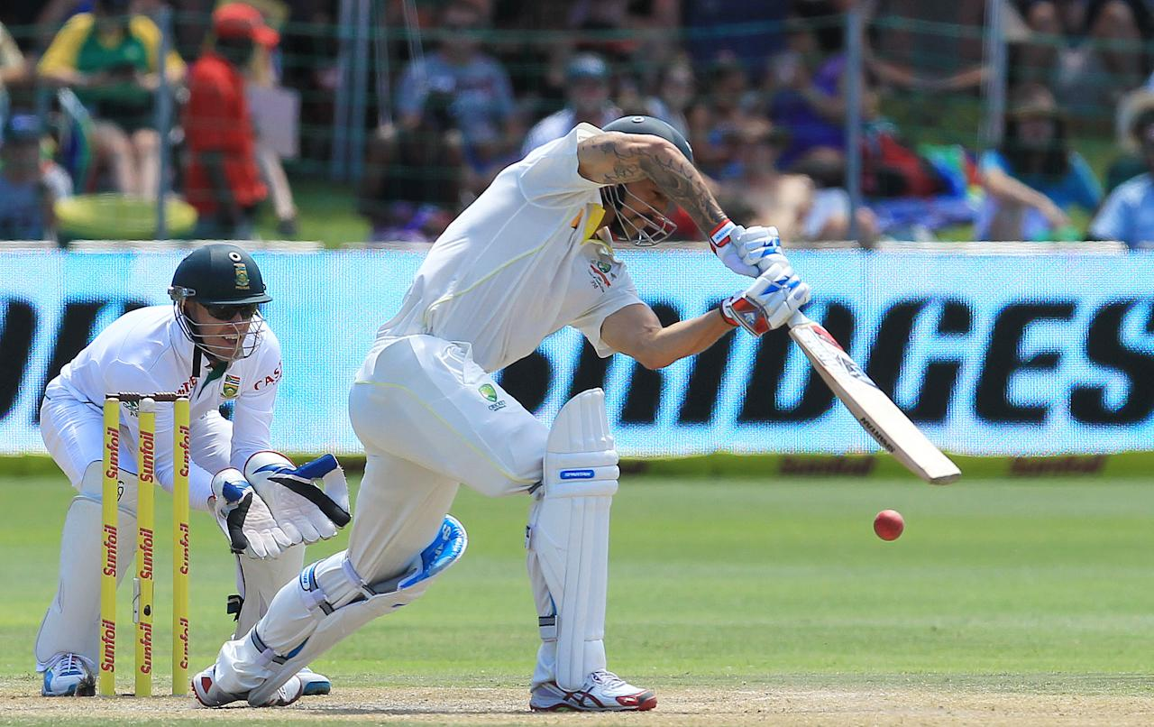 Australia's batsman Mitchell Johnson, right, plays a shot as South Africa's wicketkeeper AB de Villiers, left, watches, on the third day of their 2nd cricket test match at St George's Park in Port Elizabeth, South Africa, Saturday, Feb. 22, 2014. (AP Photo/ Themba Hadebe)