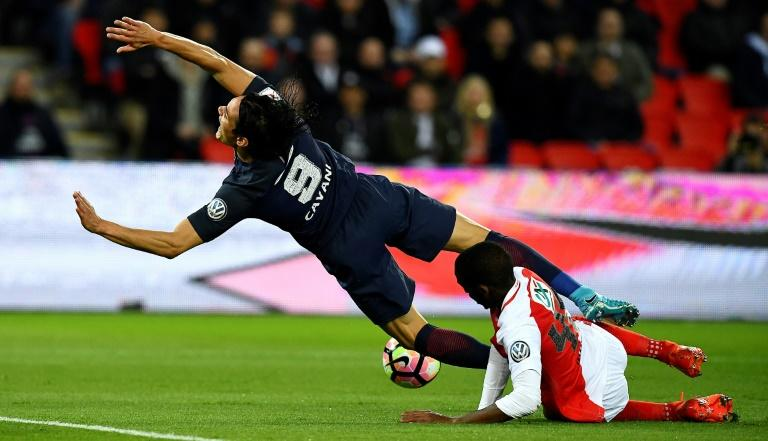 Monaco's defender Safwan Mbae vies with Paris Saint-Germain's forward Edinson Cavani during the French Cup semi-final match April 26, 2017
