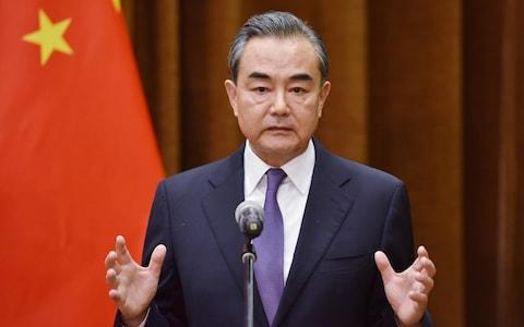 Chinese Foreign Minister Wang Yi speaks about the summit between US President Donald Trump and North Korean leader Kim Jong Un, during a joint briefing with Association of South East Asian Nations (ASEAN) Secretary-General Lim Jock Hoi at the Foreign Ministry in Beijing - Credit: Getty/Pool