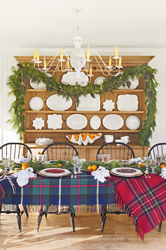 """<p><a rel=""""nofollow"""" href=""""http://www.countryliving.com/home-design/house-tours/g4928/christmas-in-connecticut/"""">This Cape Cod homeowner</a> used complementing tartan patterns to dress up her dining table for the holidays. In addition to plaid blankets, layered here as tablecloths, you can also mix in more pattern with dishware and napkins. </p>"""