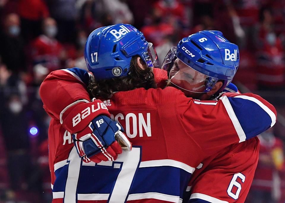 Montreal Canadiens right wing Josh Anderson celebrates with defenseman Shea Weber after scoring in overtime against the Tampa Bay Lightning.